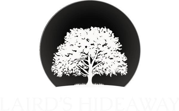 laird's hideaway white logo